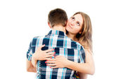 Beautiful girl hugging a loved one guy — Stock Photo