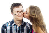 Beautiful girl kisses a guy on the cheek — Stock Photo