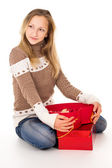 Beautiful girl sitting with gifts — Stock Photo