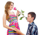 Beautiful girl with a rose and a guy — Stock Photo