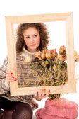 Beautiful girl with a frame and still life — Stock Photo