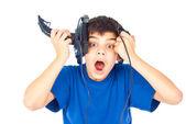 Boy holds two joystick lost — Stock Photo