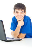 Boy learns lessons at a laptop — Stock Photo