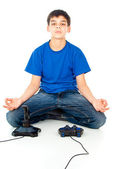 Boy meditating near the joystick — Stock Photo
