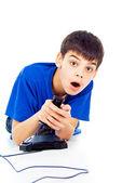Boy plays games — Stock Photo