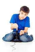 Boy plays on the joystick — Stock Photo