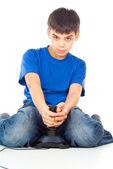 Boy plays with a joystick — Stock Photo