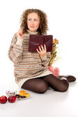 Girl reading a book in the sweater and the idea — Stock Photo