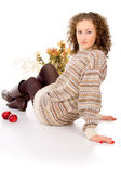 Girl sits in a cozy sweater — Stock Photo