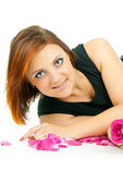 Girl with a rose and petals isolated — Stock Photo
