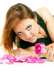 Girl with rose petals — Stock Photo