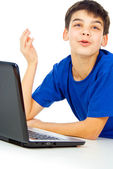 Happy boy with a laptop — Stock Photo