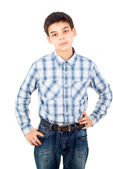 Handsome boy in a shirt stands isolated — Stock Photo