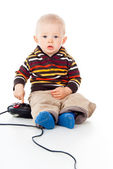 Little child boy plays with a joystick — Stock Photo