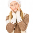 Beautiful teen girl in a cap and scarf — Stock Photo