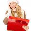 Girl in a hat holding a box and surprised isolated — Stock Photo #18008021