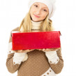 Girl in a hat holding a gift box isolated — Stock Photo #18008027