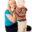 Mother comforting upset child — Stock Photo #18009327