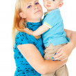 Mother holding a baby in her arms — Stock Photo #18009343