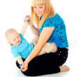 Mother plays with her baby — Stock Photo #18009409