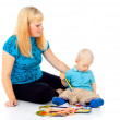 Mother with a child draws — Stock Photo #18009413