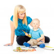 Mother with a child draws — Stock Photo #18009421