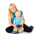 Mother with a child playing on the joystick — Stock Photo