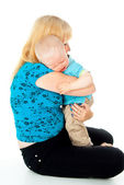 Mother comforting a crying child — Stock Photo