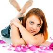 Stock Photo: Portrait of girl with petals of roses