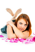 Portrait of girl with petals of roses — Stock Photo