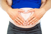 Pregnant belly with his hands on it — Stock Photo