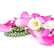 Rose petals background with flowers and beads — Stock Photo #18033407