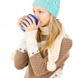 Stock Photo: Teen girl with mug in cap