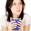 The diseased girl sitting on the bed and drink medicine — Stock Photo