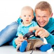 Young father playing with baby on the joystick — Stock Photo