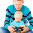Young father playing with baby — Stock Photo