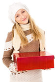 Teen girl in a hat holding a gift — Stok fotoğraf