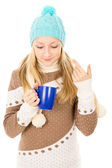 Teen girl in winter hat with cup — Stock Photo