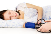 The diseased beautiful girl lying on the bed, and measure the pr — Stock Photo