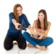 Beautiful girls play on the joysticks — Stock Photo