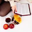 Bible, candy and tea — Stockfoto