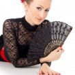 Carmen lying a girl with fan — Stock Photo