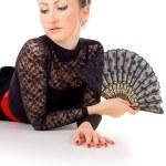 Carmen lying a portrait of a girl with fan — Stock Photo
