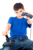 Boy sitting with two joysticks — Stock Photo