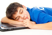 Boy was tired and fell asleep on a laptop — Stock Photo