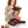 Girl reading a book and eating — Stock Photo