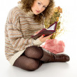 Girl reading a book in a sweater — Stock Photo #18771163