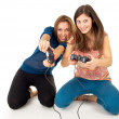 Girls play video games on the joystick — Stock Photo