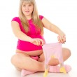 Pregnant woman with baby clothes — Stock Photo #18773665
