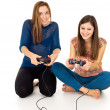 Two girls are playing video games — Stock Photo